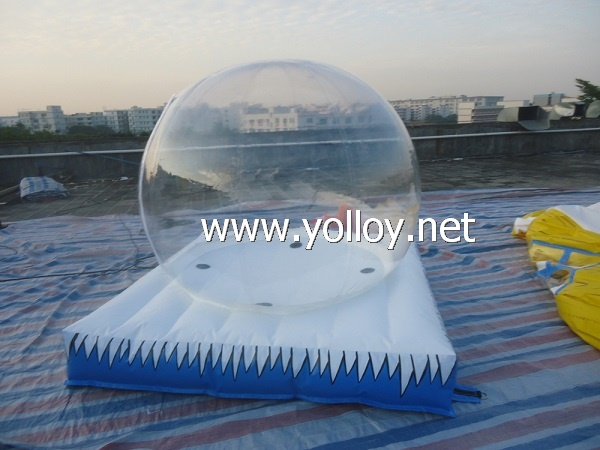 Inflatable snow globe with air bouncy mat