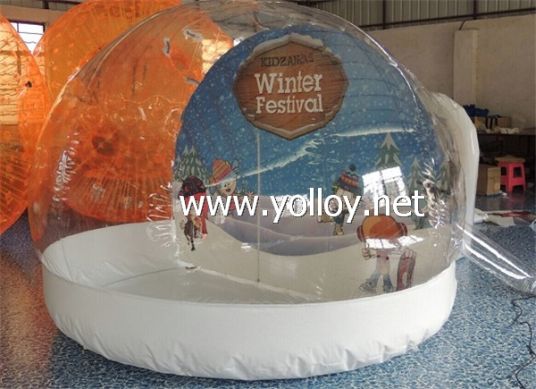 Inflatable snow globe for holiday decoration