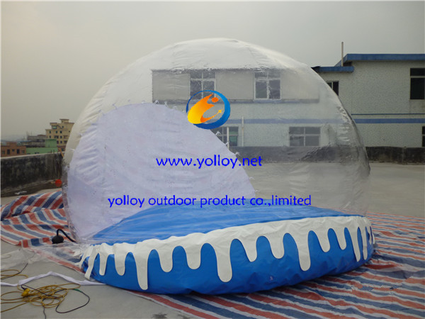 christmas inflatable snow globes outdoors