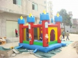 Large blue inflatable slide with bouncy house